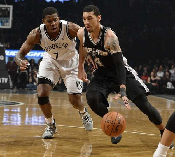 San Antonio Spurs guard Danny Green drives the