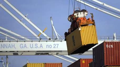 A ship-to-shore crane unloads a container in Savannah,