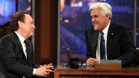 Billy Crystal talks to host Jay Leno during