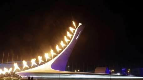 The Olympic Cauldron is lit during the opening