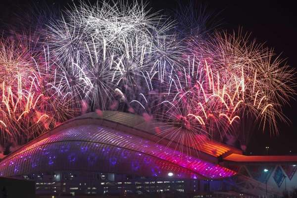 Fireworks explode over Fisht Olympic Stadium at the