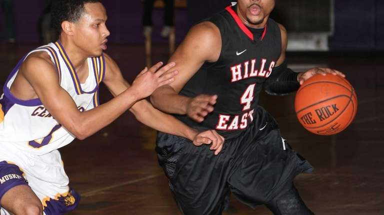 Half Hollow Hills East's Mikeal Simon drives to