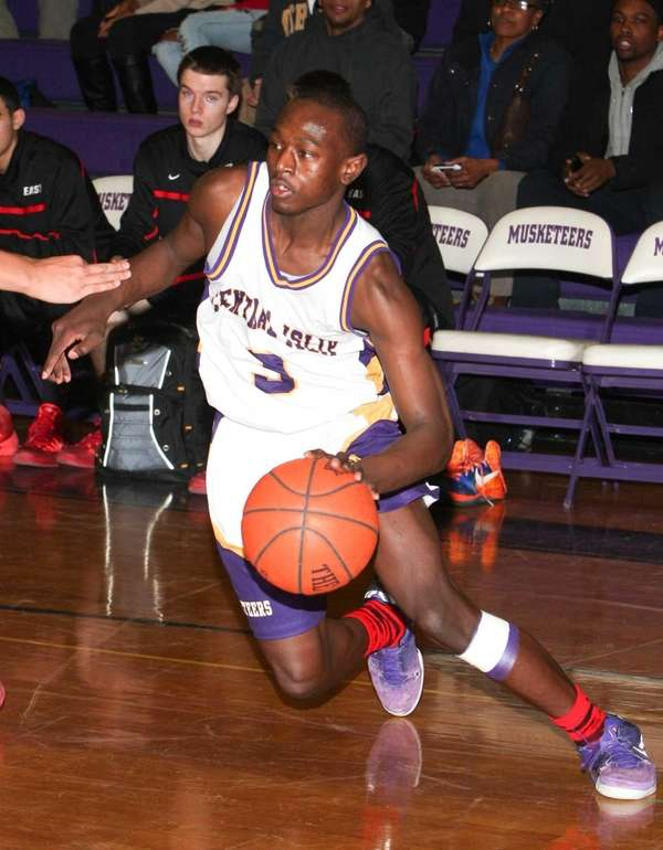 Central Islip's Brandon Hodge brings the ball to