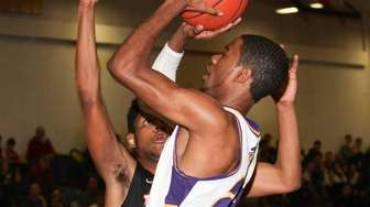 Central Islip's Donovan Slater goes up to the