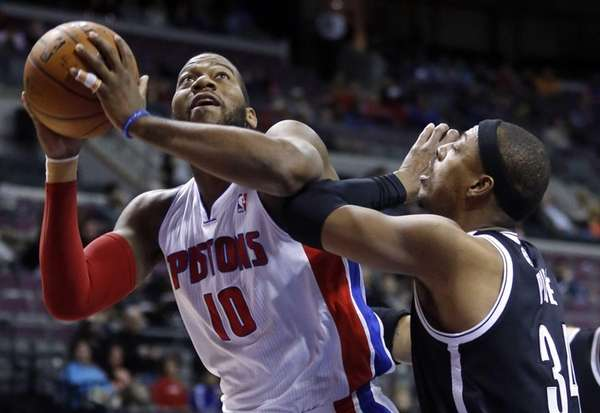 Detroit Pistons center Greg Monroe tries to go