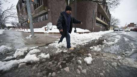 Pedestrians in Freeport try to make their way
