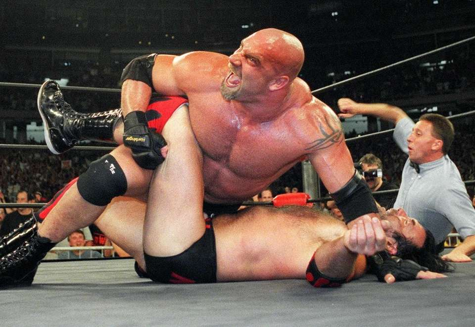 WCW Heavyweight Champion Bill Goldberg puts Scott Hall