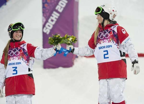 Gold medalist Canada's Justine Dufour-Lapointe, right, celebrates with