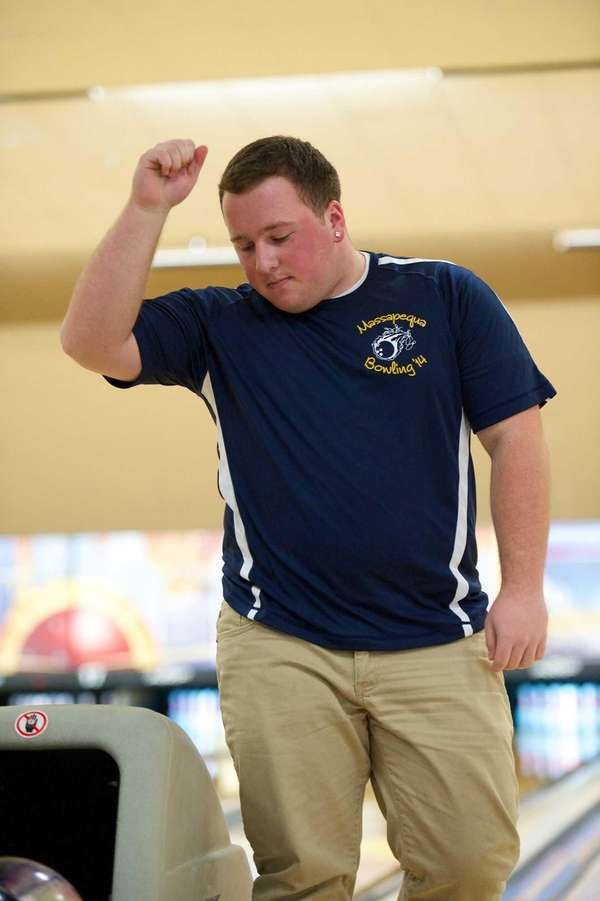 Massapequa's Mike Votinelli reacts after bowling a split