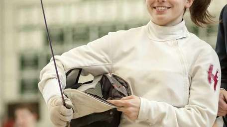 Whitman's Alexandria Alpy competes in the Suffolk fencing