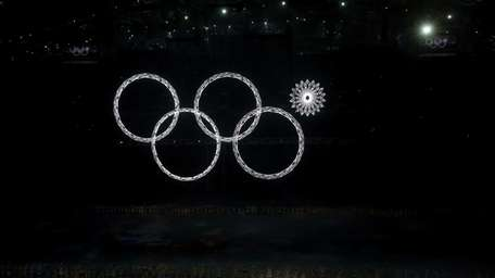 Snowflakes transform into four Olympic rings with one