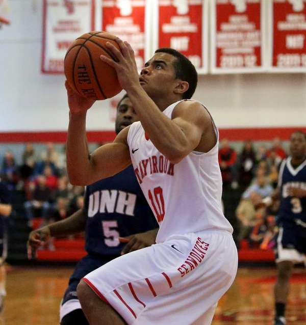 Stony Brook's Carson Puriefoy lll drives past New