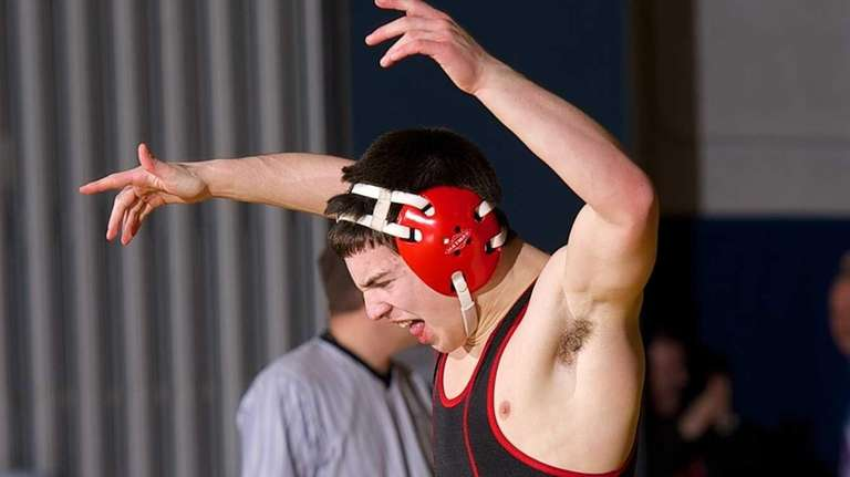 Tom Repalone of Connetquot reacts after pinning Rocky
