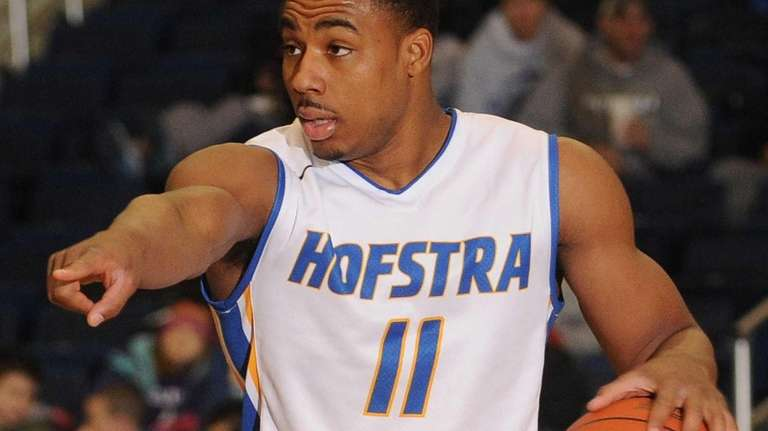 Hofstra's Dion Nesmith directs the offense during the