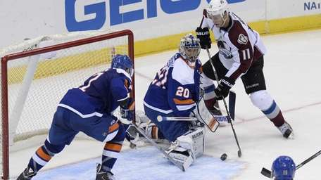 Islanders goalie Evgeni Nabokov can't stop the puck