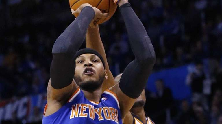 Carmelo Anthony (7) has his shot blocked by