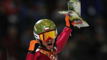 Poland's Kamil Stoch celebrates winning the gold medal