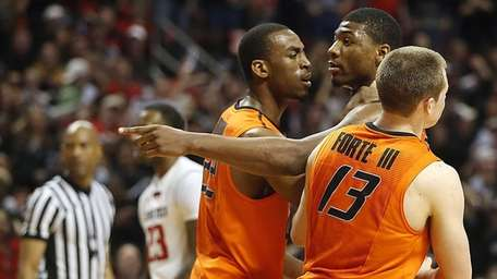 Oklahoma State's Markel Brown (22) and Phil Forte