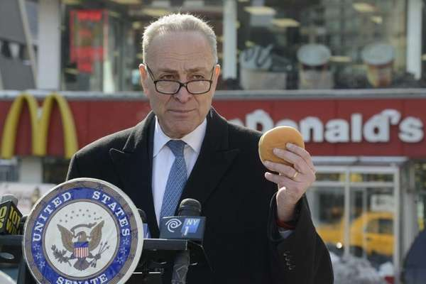 U.S. Senator Charles E. Schumer stands in front