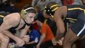 St. Anthony's Kevin Jackson, left, wrestles St. Anthony's