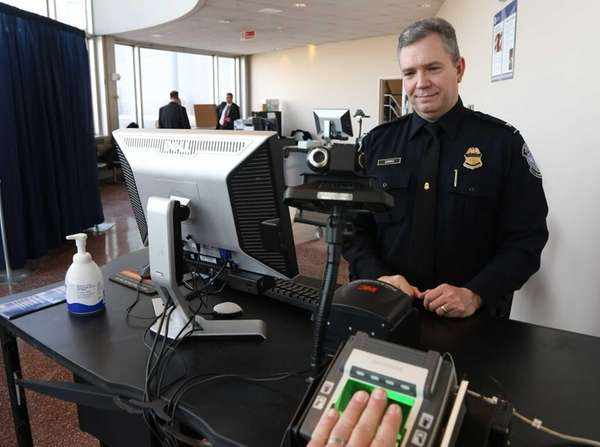 A U.S. Customs and Border Patrol agent demonstrates