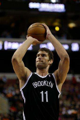 Brook Lopez takes a shot during a game