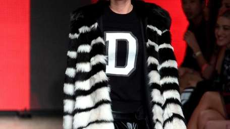 A model walks the runway for the DKNY