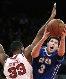 Creighton's Doug McDermott (3) shoots against St. John's