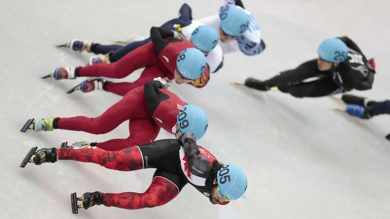 Charles Hamelin of Canada leads the field in