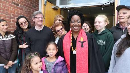 The Rev. Hope Johnson with members of her