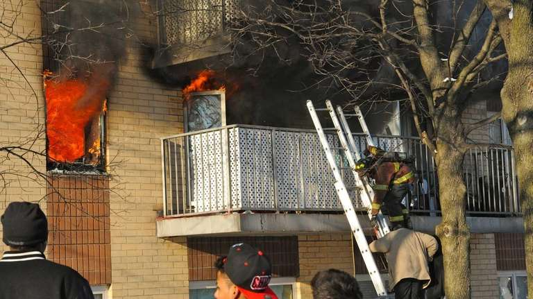 Two people are rescued from a balcony at