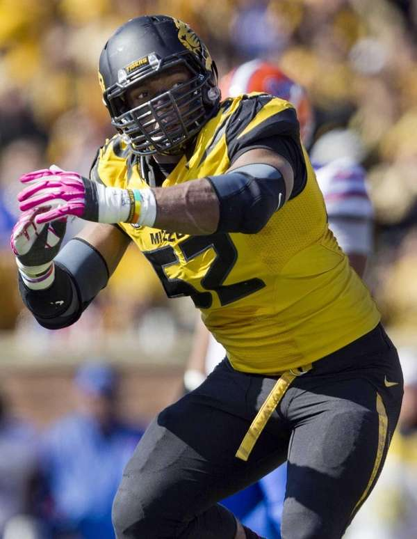 Missouri Tigers defensive lineman Michael Sam (52) celebrates