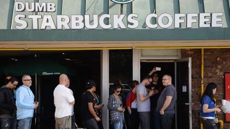 Customers lined up for free coffee and food