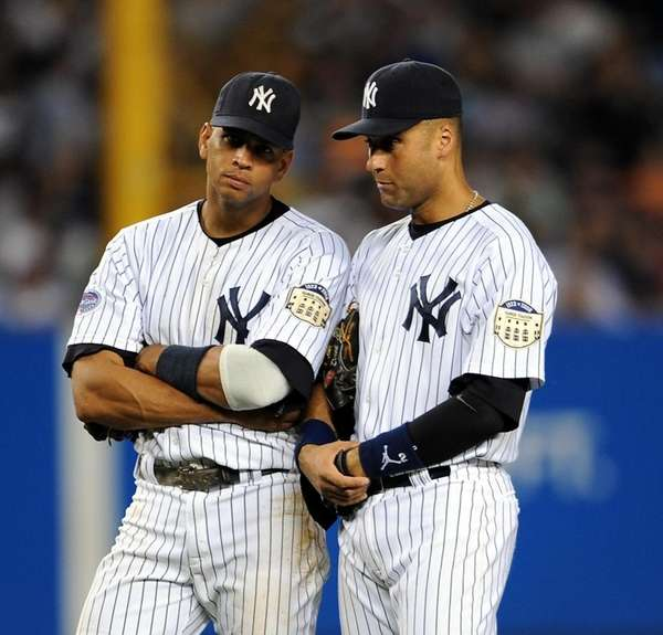 Alex Rodriguez, left, and Derek Jeter discuss things