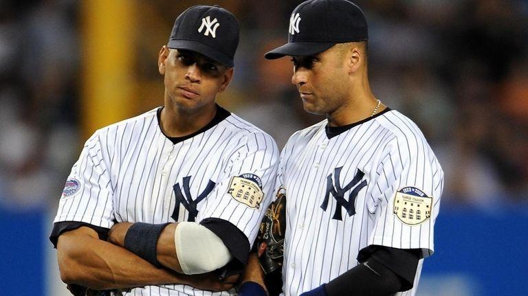 Alex Rodriguez, left, and Derek Jeter discuss things