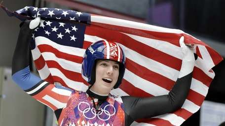 Erin Hamlin of the United States waves the