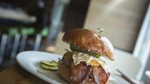 """The """"breakfast burger"""" is topped with fried egg,"""