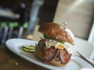"The ""breakfast burger"" is topped with fried egg,"