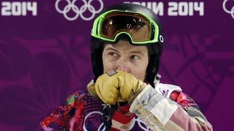 Shaun White of the United States wipes his