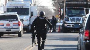 Nassau police investigate the scene where Rohan Kahn
