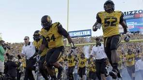 Missouri's Michael Sam, right, and Sheldon Richardson run