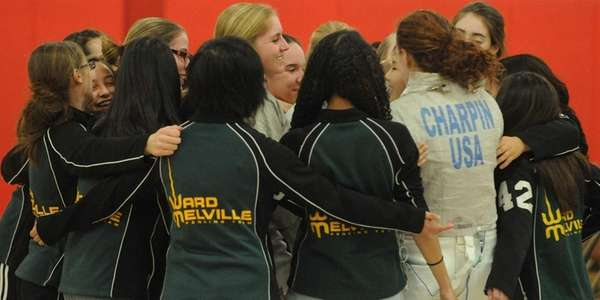 The Ward Melville girls fencing team celebrates after
