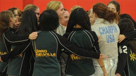 The Ward Melville girls fencing team celebrates after