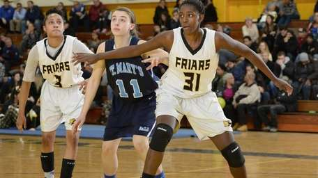 St. Anthony's Jayla Jones-Pack moves to box out