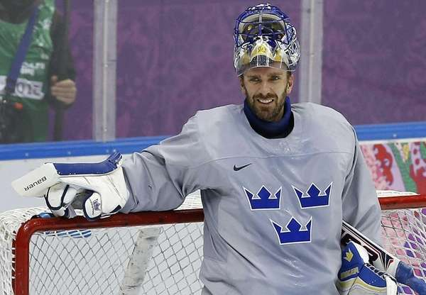 Sweden goaltender Henrik Lundqvist takes a break during