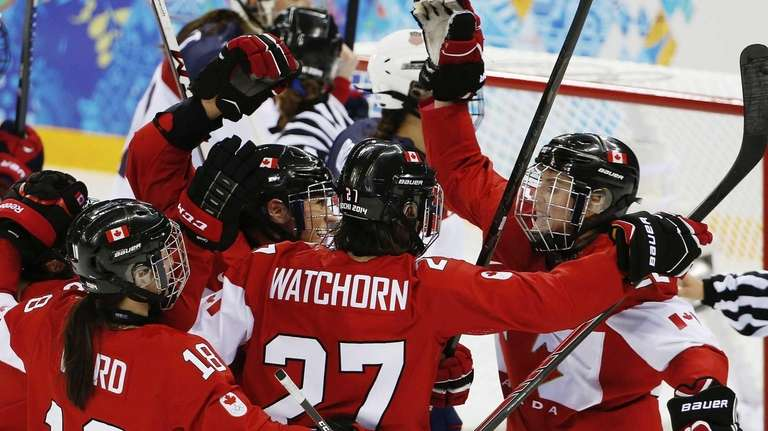 Hayley Wickenheiser of Canada, right, celebrates with her