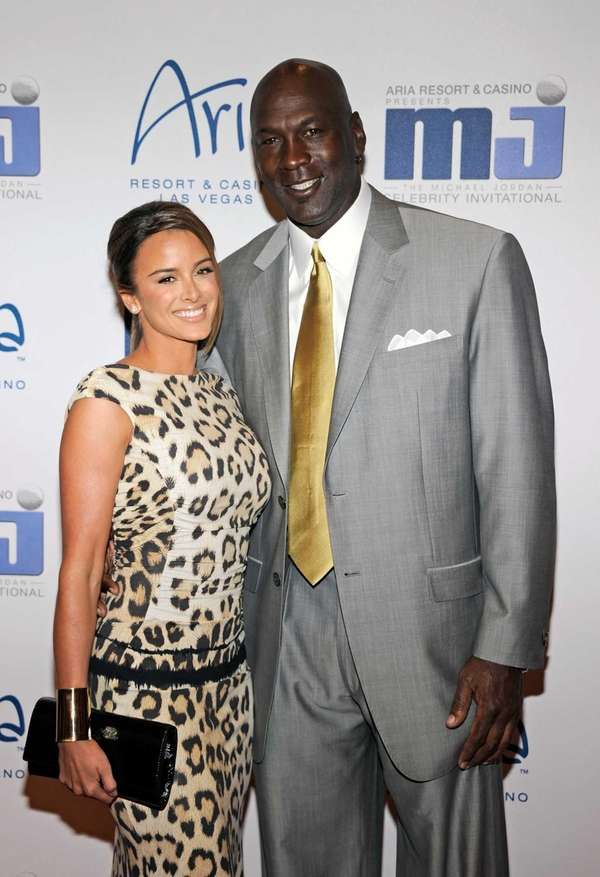 Charlotte Bobcats owner Michael Jordan, right, and his