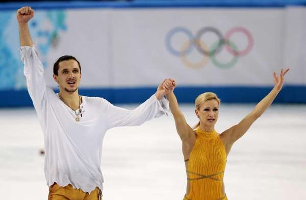 Tatiana Volosozhar and Maxim Trankov of Russia acknowledge
