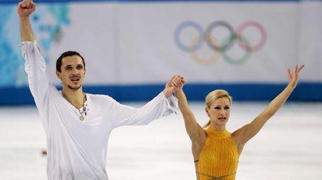 Tatiana Volosozhar and Maxim Trankov of Russia acknowledge