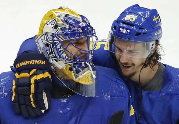 Sweden goaltender Henrik Lundqvist, left, is congratulated by